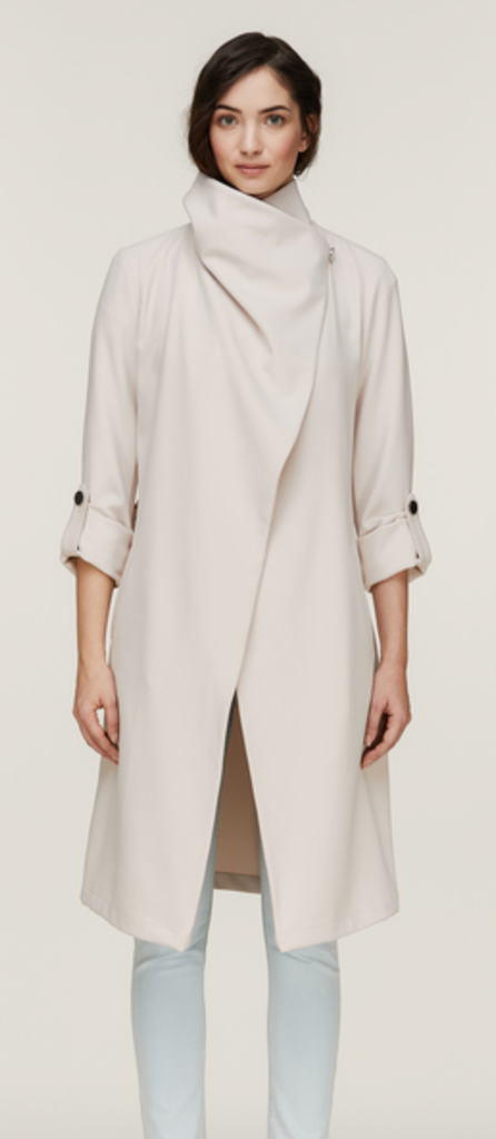 UNIKONCEPT: Lifestyle boutique; image shows a black trench coat by son and kyo. The Ornella coat in pearl features pre rolled sleeves fashioned with silver buttons, a large collar and a stretchy belt matching the fabric and colour of the trench. It is mid length and can be worn multiple ways.