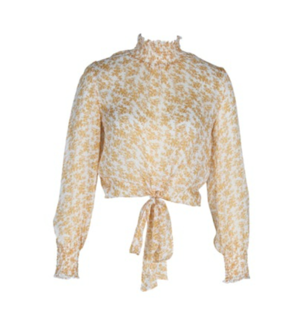 UNIKONCEPT Lifestyle boutique: the image shows the Lana High Neck Blouse by MinkPink. This high neck blouse is a sheer white with a yellow floral print. It is long sleeve with shirring through the neck and the cuff. A looser fit sleeve allows for a breathable, billowing fit through the arm. The hem features a tie detail in the front centre of the blouse.