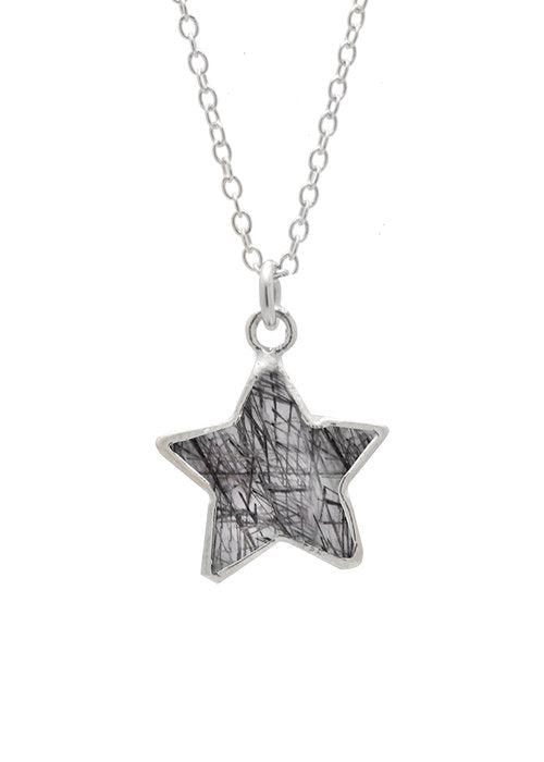 Image shows a silver Sarah mulder necklace. The stargazer necklace is a thin silver chain with a semi precious gemstone star pendant