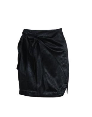 Model wears a Minkpink Black, mini, satin skirt with wrap detail that ties in the front at the side. The dinner date satin skirt is a mini skirt with a subtle beautiful details such as a front tie and small slit where the skirts fabric wraps over each other.