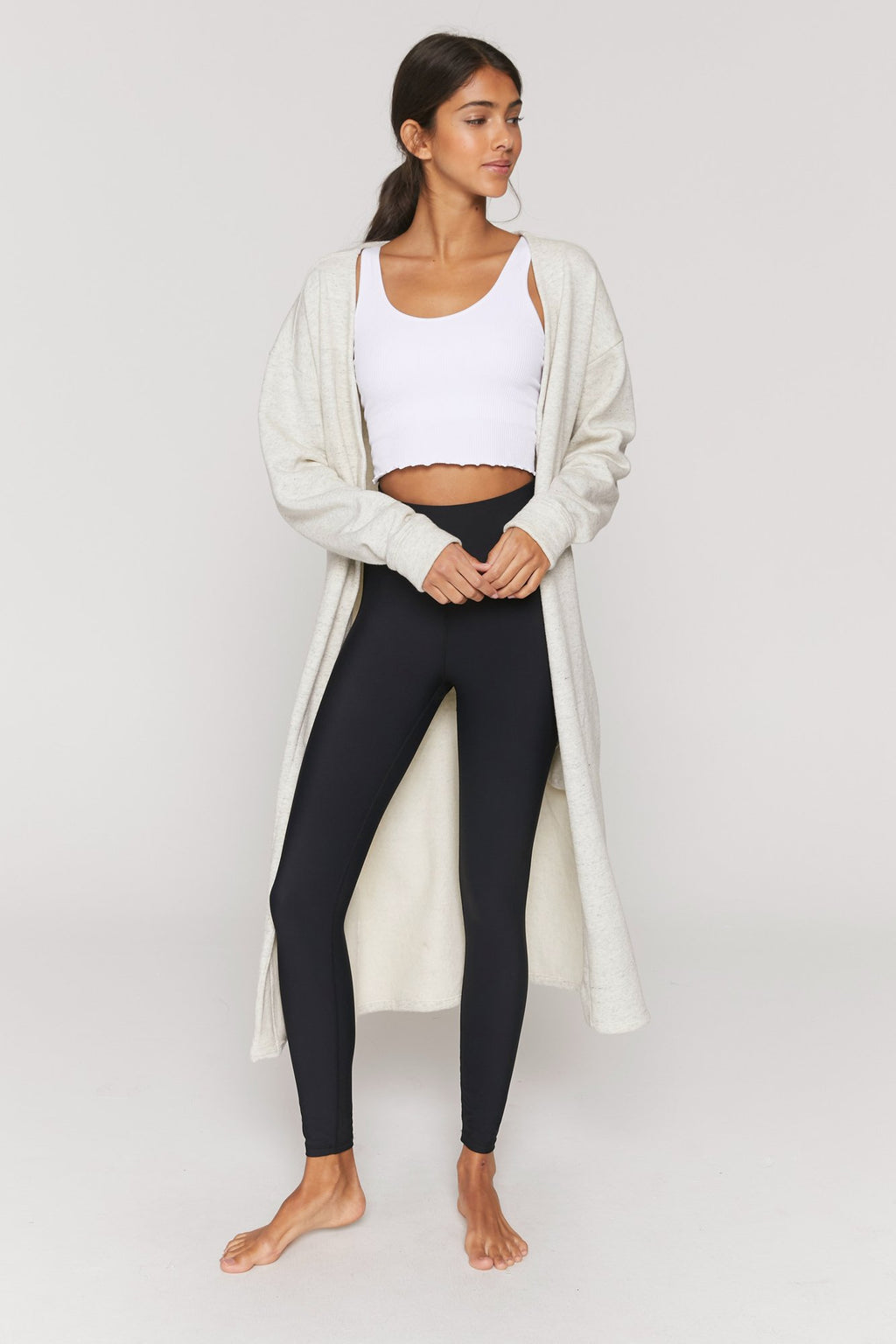 UNIKONCEPT: Lifestyle boutique; Image shows a cream coloured oversized duster. The Layer up fleece Cardigan by spiritual gangster is a cream coloured cardigan it goes to about knee length and features an inner fleece side and two side pockets.