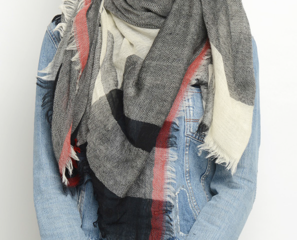 The aafke scarf by Moment by Moment is a black, red and cream colour blanket scarf.