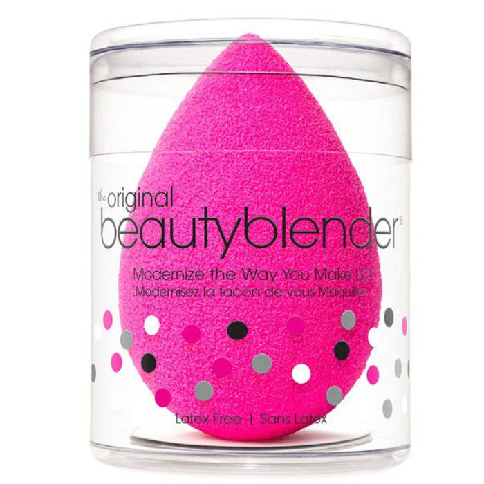 this is a bright pink beauty blender, it is shaped like an egg and is used to apply makeup.