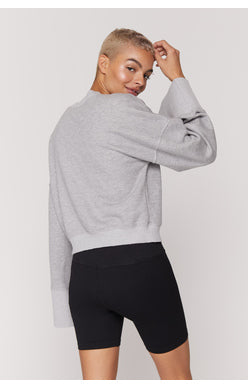 UNIKONCEPT Lifestyle boutique: image shows the Malia Wide Sleeve Crew in grey by Spiritual Gangster. This pant leg crew neck features a rounded neckline and loose fitting, full length sleeves.