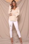 UNIKONCEPT: Liefstyle boutique; Image shows an almond coloured knit sweater by Runaway. The cloud nine sweater is a v neckline sweater that features vertical knit detailing throughout, two side slits on either side, and three tiers of knit bell sleeves.