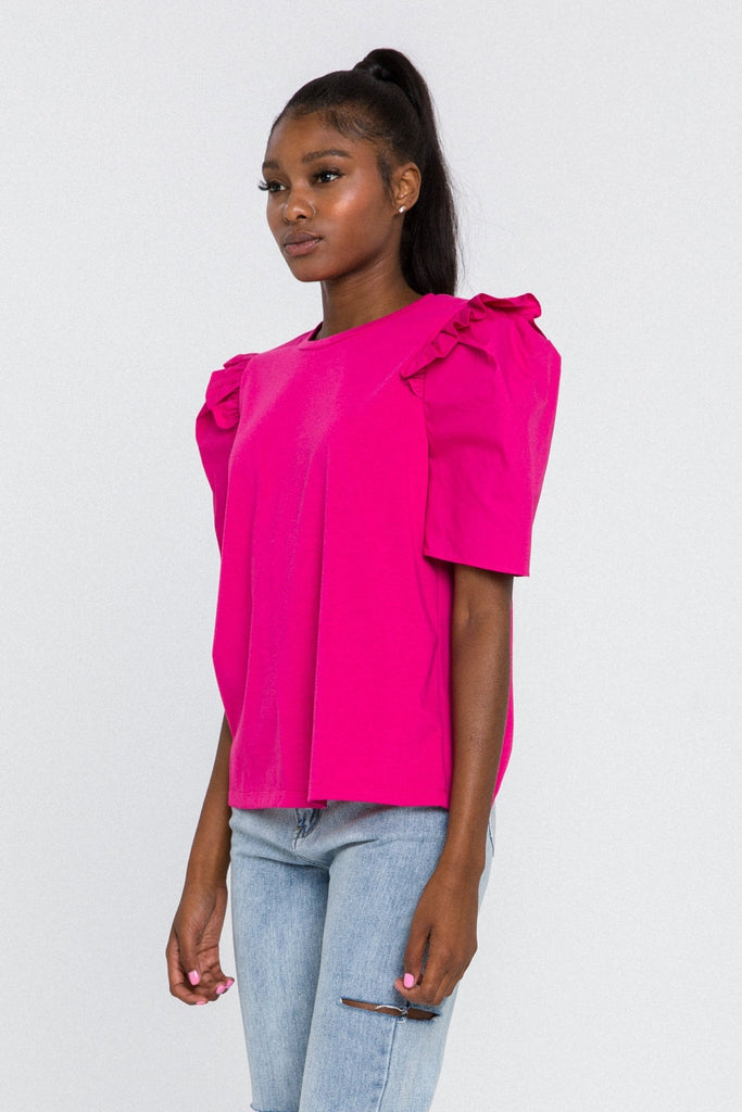 UNIKONCEPT Lifestyle boutique; image shows the Elevated Puff Sleeve Tee in pink by English Factory. This relaxed tee features a crew neckline and puffed sleeves adorned by a ruffle detail on the shoulder of the shirt.