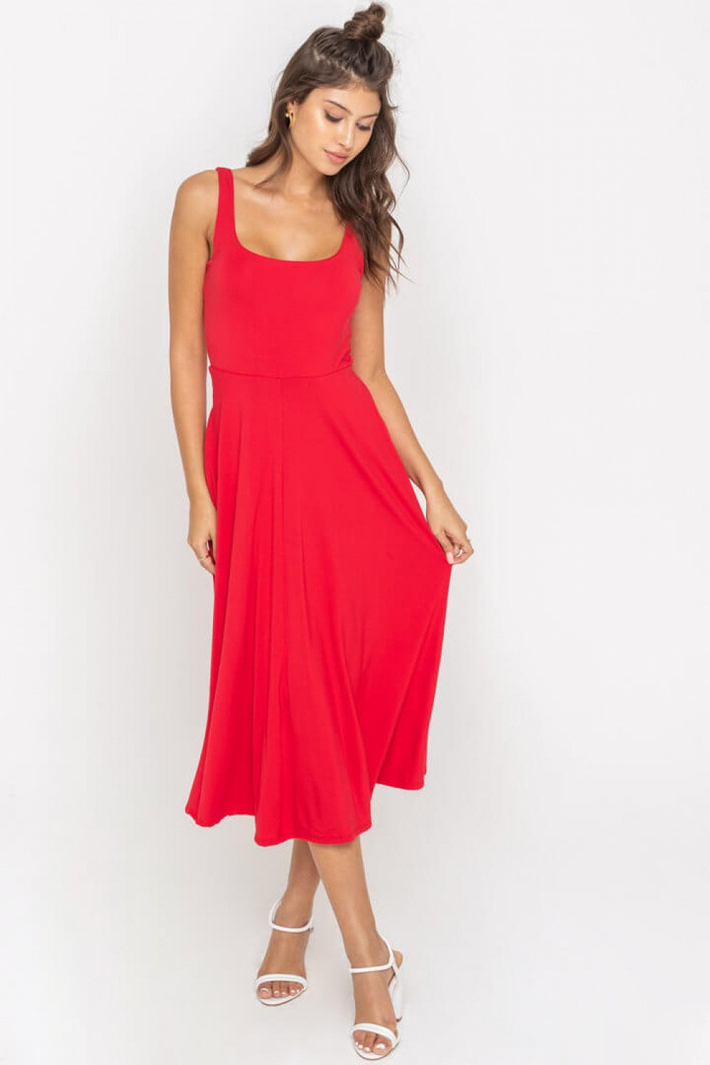 UNIKONCEPT Lifestyle boutique: Mode is wearing a bright red mid length lush dress. The Lola dress has a square neckline, thin straps, is an a line cut dress and features pockets