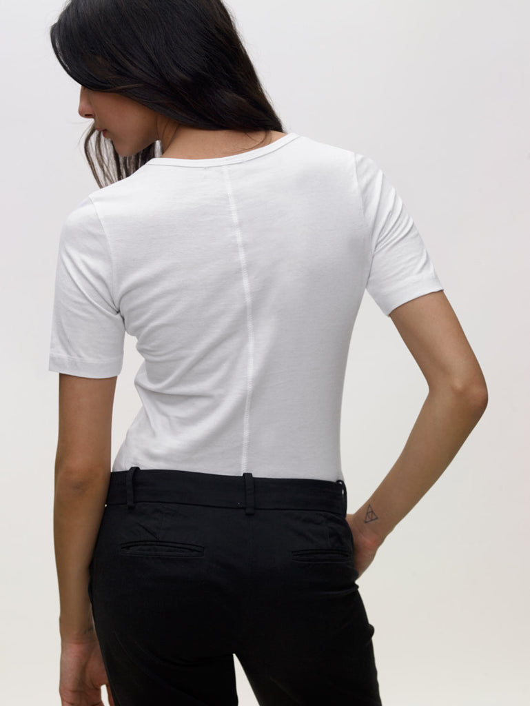 Model wearing white, crew neck, slim, KOTN t-shirt. View of Models back.