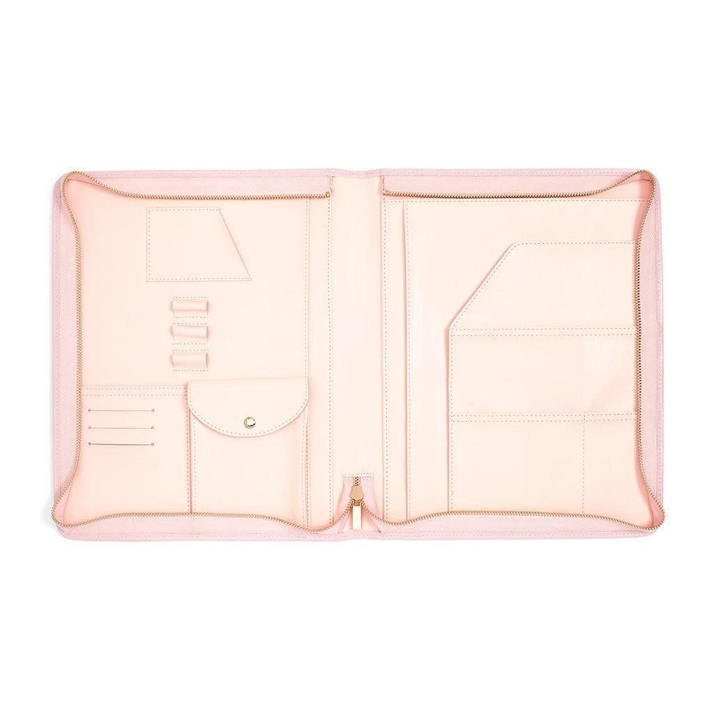 Image shows a pastel pink folder case with a large zipper to close it. The folder case has white and baby pink flowers all over it with green leaves.