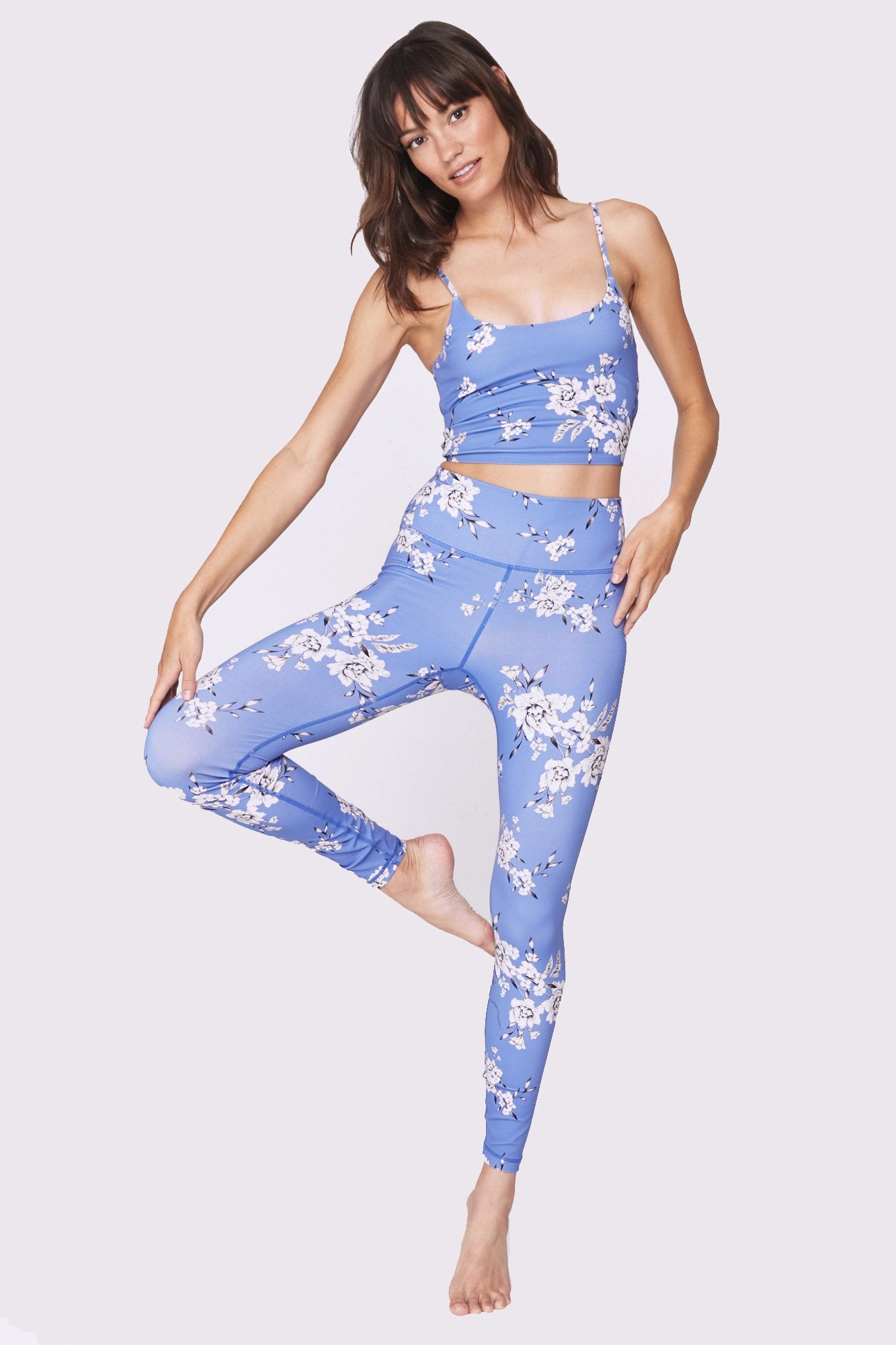 43a3947f425 Image shows a model wearing a floral came by spiritual gangster. The floral  practice came