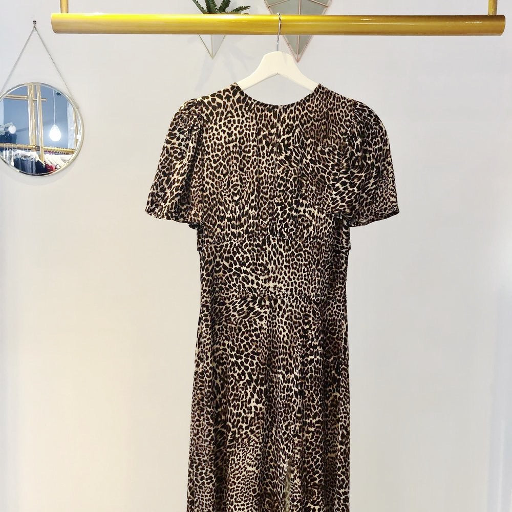 UNIKONCEPT: Lifestyle boutique; Image shows a leopard printed tee shirt style maxi dress by sugar lips. The Dance all night dress is a short sleeved scoop neckline maxi dress. Feature include a keyhole open back and elastic detailing at the back to give a stretchy comfortable feel, it also has a front slit that goes to about the knee.