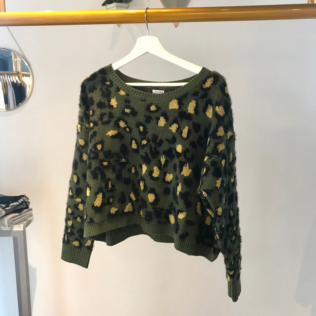 UNIKONCEPT: Lifestyle boutique; image shows a cropped En creme crewneck. The Gabbie leopard sweater is olive green in colour and features a black and yellow leopard print throughout the majority of the sweater.