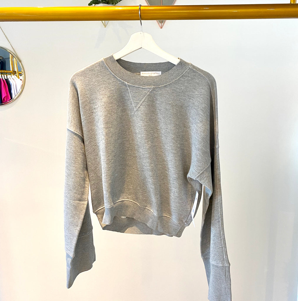 UNIKONCEPT Lifestyle boutique; image shows the Malia Wide Sleeve Crew in grey by Spiritual Gangster. This crew neck sweater is pant length with loose wide fitting sleeves.