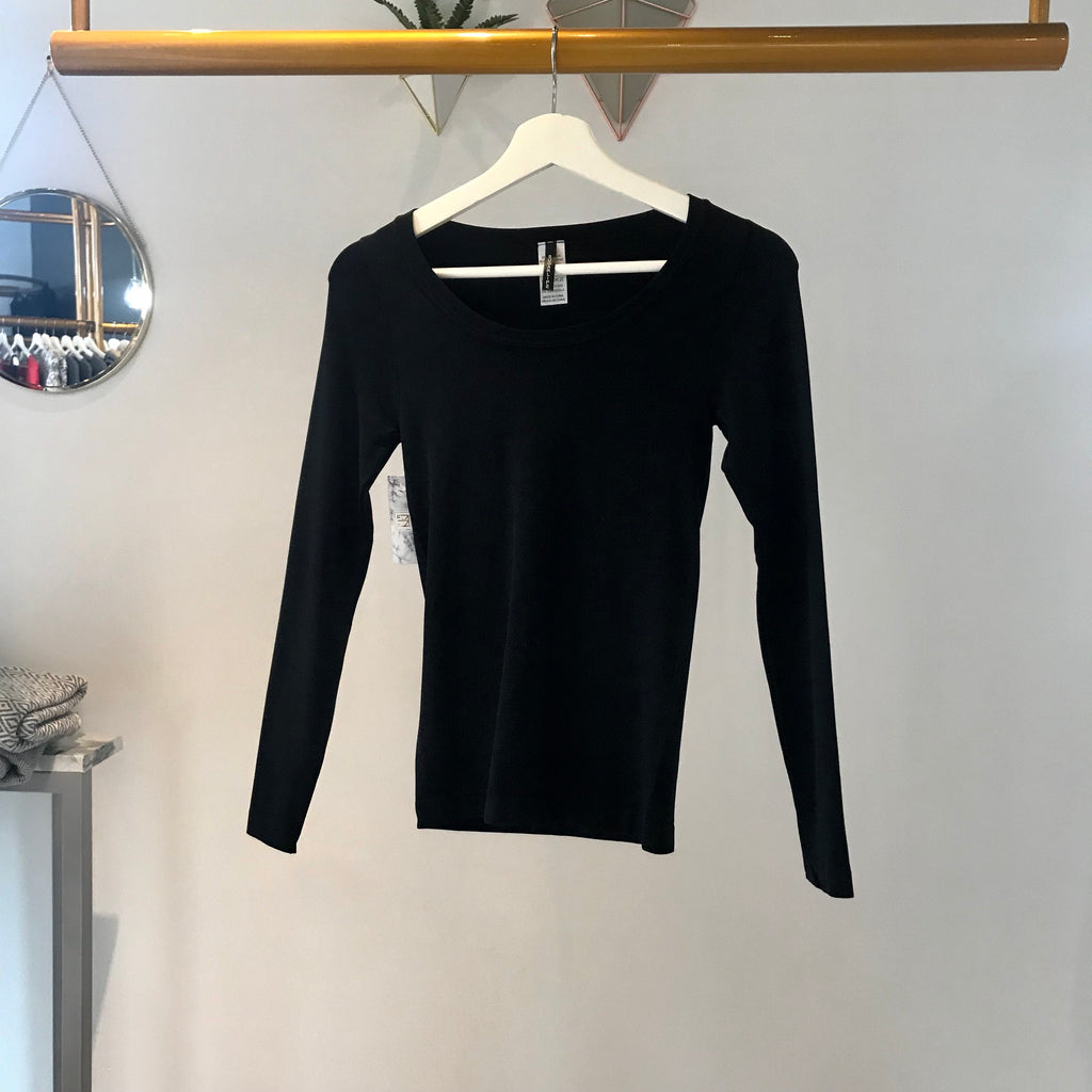 UNIKONCEPT: Lifestyle boutique; Image shows a black long sleeve top with a v neckline by sugar lips. The basic long sleeve by sugar lips is a basic long sleeve black v neck top.