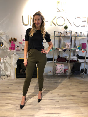 Model is wearing high-waist, olive, slim sam and lava jogger pant. The Gwen pants comes with horizontal ribbing.