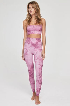 Model is wearing high-waist seamless, Light pink and baby pink spiritual gangster tie-dye leggings. The Seamless legging in tie dye pink is a full length legging with a super high waist and ribbing on the waistband for added compression.
