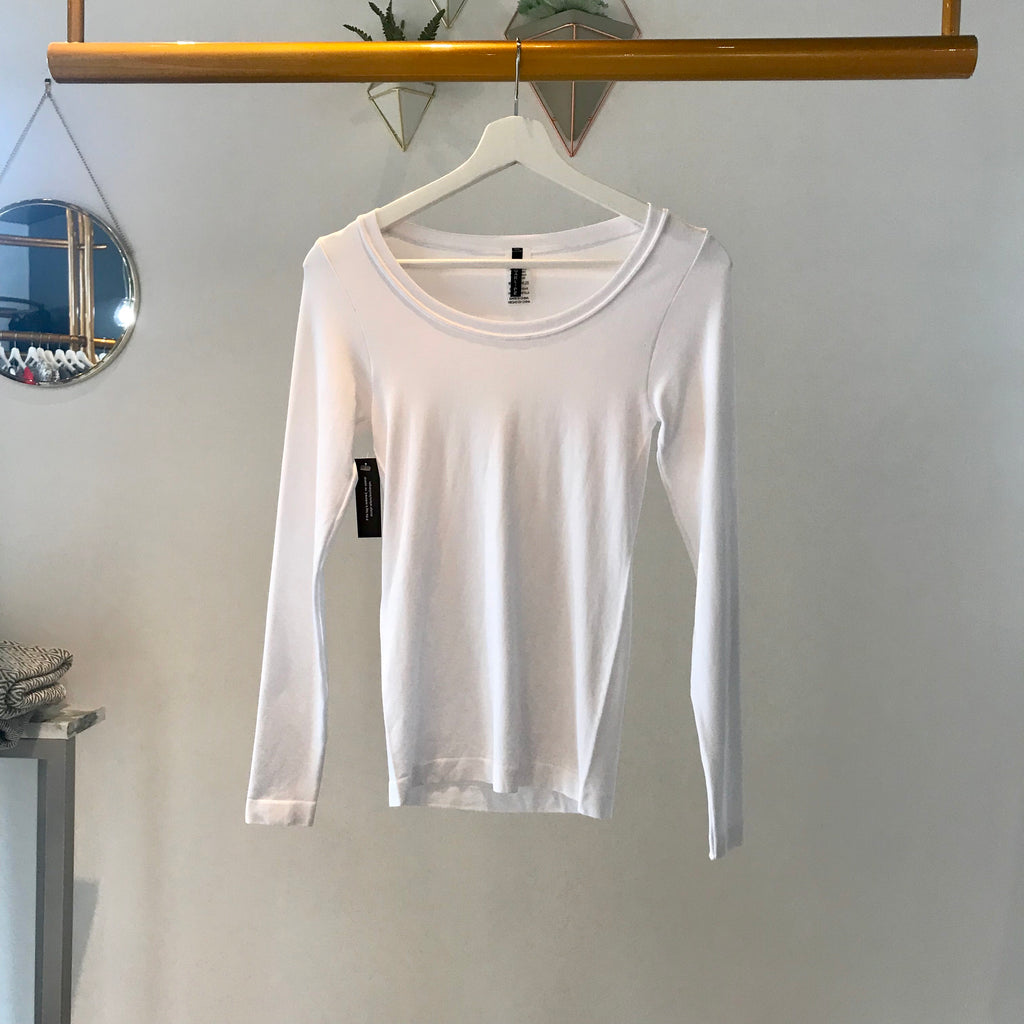 UNIKONCEPT: Lifestyle boutique; Image shows a white long sleeve top with a v neckline by sugar lips. The basic long sleeve by sugar lips is a basic long sleeve white v neck top.