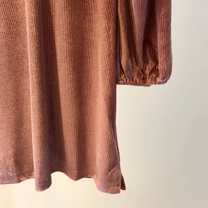 UNIKONCEPT: Lifestyle boutique; image shows a three quarter length sleeve English factory top. The pixie dust velvet top is a ribbed, velvet fabric that features a puffed sleeve, a cowl neckline and a keyhole button back.