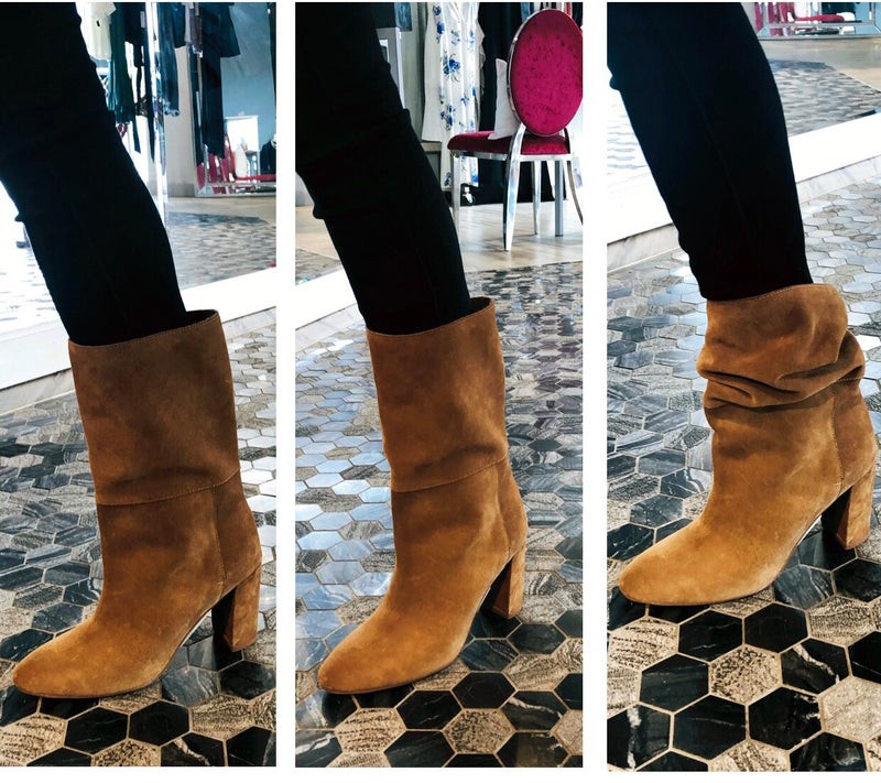 UNIKONCEPT Lifestyle boutique: Image shows a model wearing honey brown Chinese laundry booties. The Keep up boot in honey brown is a rounded toe boot with a thick a cuff around the ankle to the mid calf. It is a faux suede and the heel is 3 inches.