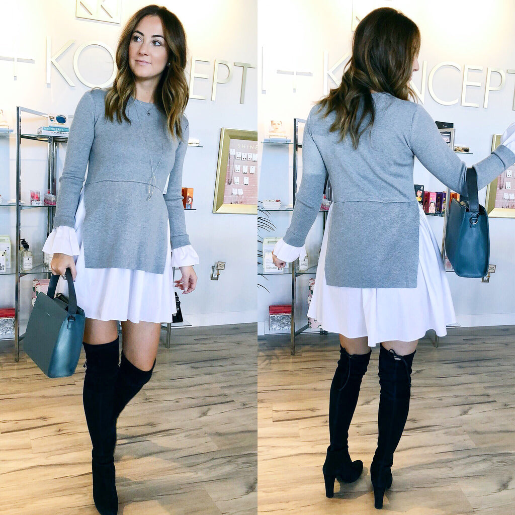 UNIKONCEPT Lifestyle boutique: Image shows a two tiered English factory dress. The Sofia dress in grey is a long sleeve dress with two layers. Underneath is a white a-line skirt with an Grey knit overlay. The Sofia dress also features the same white material on the sleeve to create a bell like sleeve.