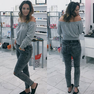 Jovana is wearing brushed grey denim pants with raw ankle, slightly cropped hem.