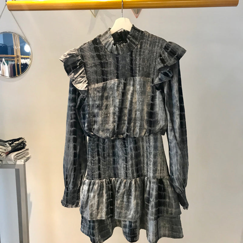 UNIKONCEPT: Lifestyle boutique; Image shows a tie dye printed English Factory dress. The Carefree tie-dye dress is a turtlenecked dress with ruffles along the shoulders, puffy sleeves and ribbed elastic detail around the neckline and torso. It is a long sleeve short/mini dress that reaches about 2 inches above the knee dependent on size and the figure of the individual.