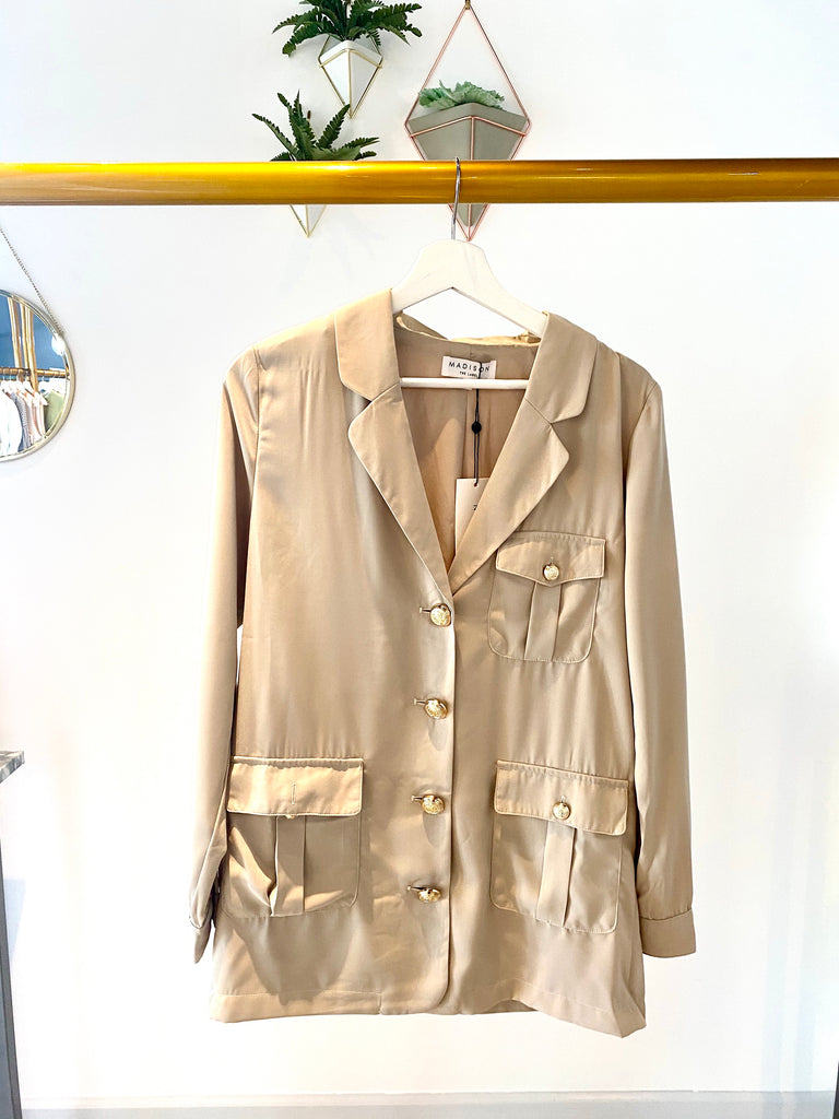 UNIKONCEPT Lifestyle boutique; image shows the Brooklyn Button Up top in camel by Madison the Label. This button up blazer style shirt features a deep v collared neckline. There are gold accent buttons and pocket details on the front. The shirt is an oversized fit.