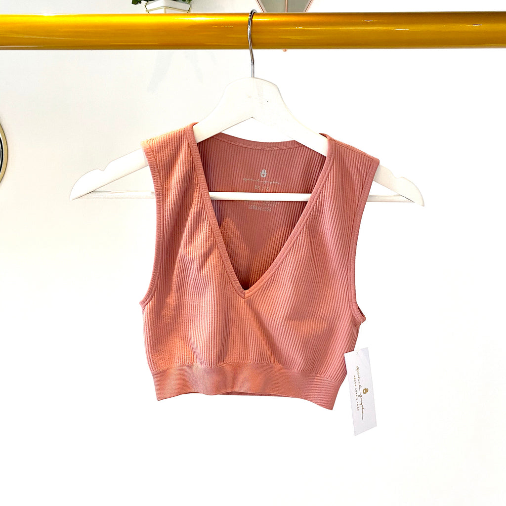 UNIKONCEPT Lifestyle boutique; image shows the Metta Plunge Brami top in cinnamon by Spiritual Gangster. This rust pink tank styled bra top features a plunging v-neckline and a ribbed fabric.