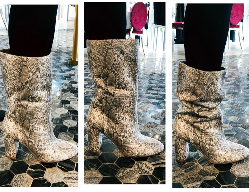 UNIKONCEPT Lifestyle boutique: Image shows a model wearing snakeskin printed Chinese laundry booties. The Keep up boot in a snakeskin print is a rounded toe boot with a thick a cuff around the ankle to the mid calf. It is a faux suede and the heel is 3 inches.