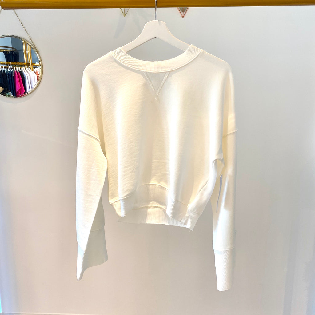 UNIKONCEPT Lifestyle boutique; image shows the Malia Wide Sleeve Crew in white by Spiritual Gangster. This crew neck sweater is pant length with loose wide fitting sleeves.