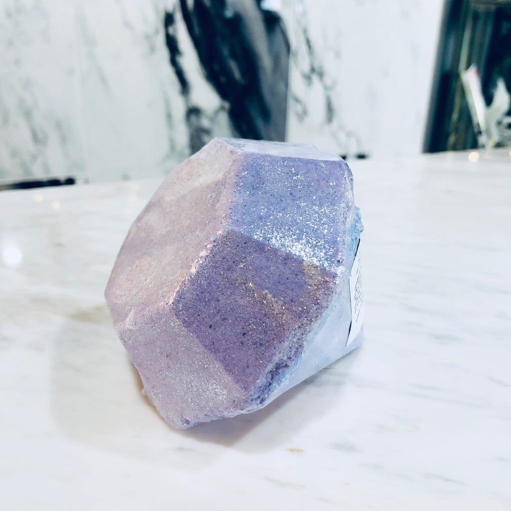 This is a large purple diamond bath bomb with glitter in it.