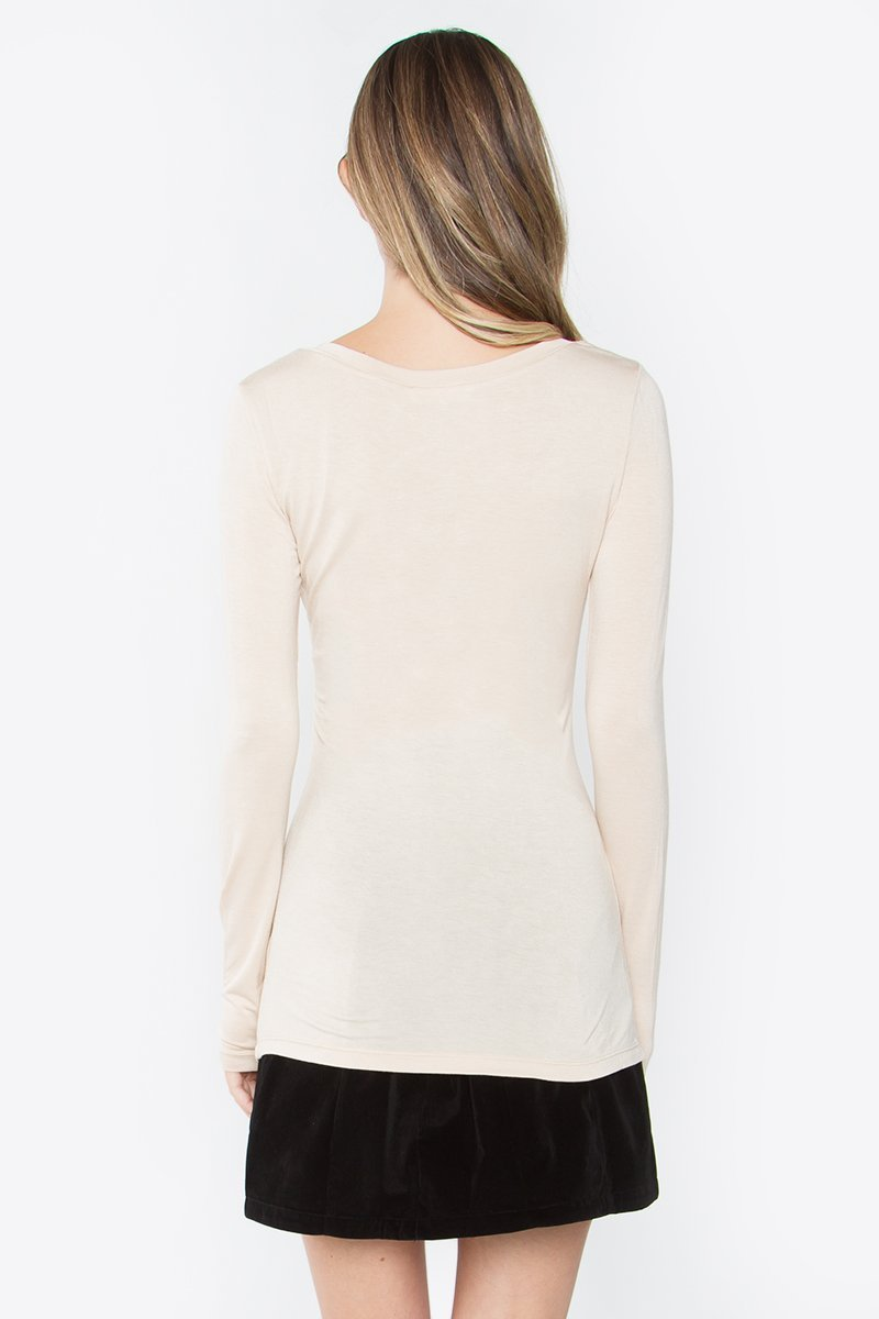 UNIKONCEPT Lifestyle boutique: Model is wearing a sugar lips long-sleeve. The Keegan top in beige is a v-neck creme top.