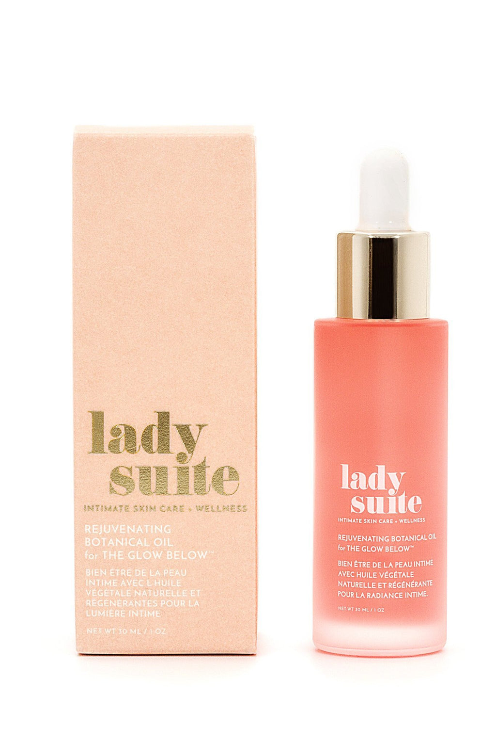 "Flay lay of product, the pink bottle with a gold top beside the box for the product that reads ""Lady Suite"", in a light pink."