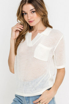 UNIKONCEPT Lifestyle boutique: Model is wearing a white knit short sleeve top by Lush. The Loop hole top is a short sleeved wide knit top, it is see through with details such as a square pocket over the left breast and a v neckline
