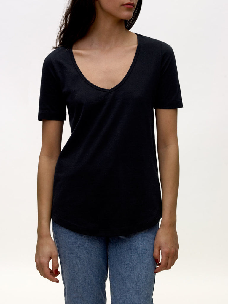 Model wearing black, v-neck, KOTN  t-shirt.