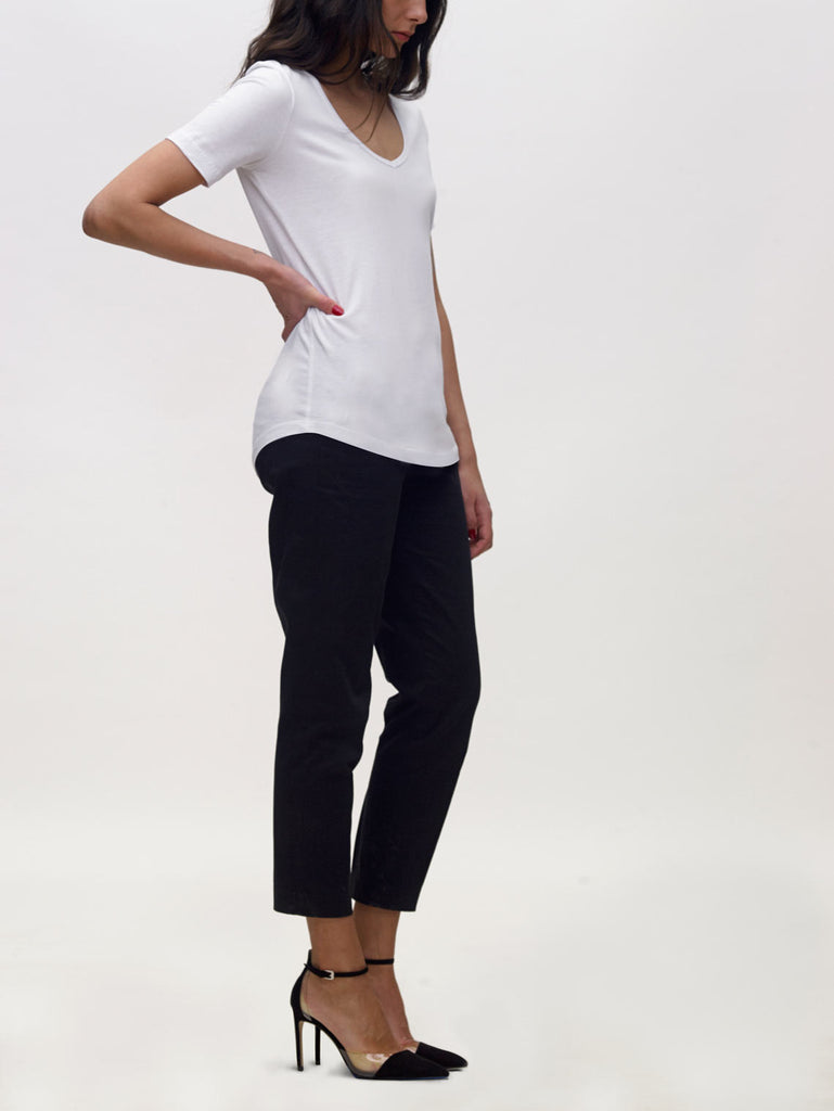 Model wearing white, v neck, KOTN t-shirt.