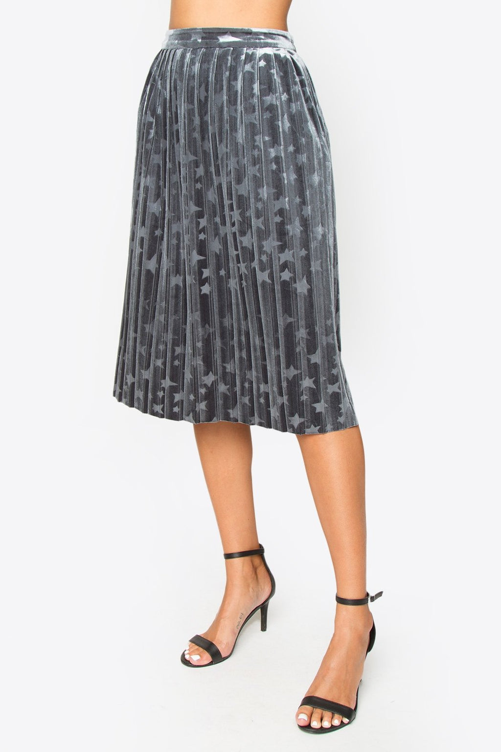 UNIKONCEPT: Lifestyle boutique; Image shows a grey a-line pleated skirt by sugar lips. The Gigi pleated skirts features a soft light grey colour with a subtle starred print throughout. The skirt features an elastic waistband with a side zipper and is knee length.