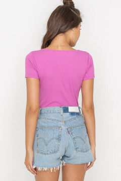 UNIKONCEPT Lifestyle boutique: Model is wearing a lilac/ hot pink ribbed bodysuit by Lush. The Lola bodysuit is short sleeved with a square neckline.