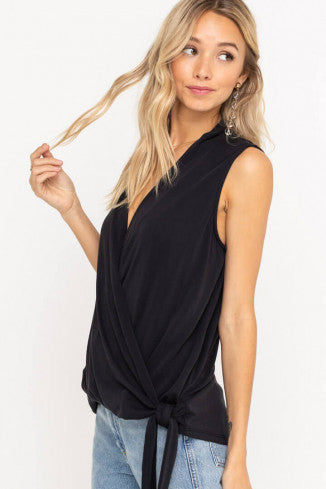 UNIKONCEPT Lifestyle boutique: Model is wearing a black thick strapped camisole blouse by lush. The black beauty top is the blackest black in colour, features a deep V plunged neckline and a side tied bottom.