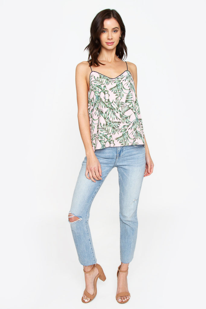 UNIKONCEPT Lifestyle boutique: Model is wearing pink, loose fitting sugar lips camisole. The Palm leaf cami features green palm leaves pattern all over and trimmed with a dark grey line that moves to the spaghetti straps.