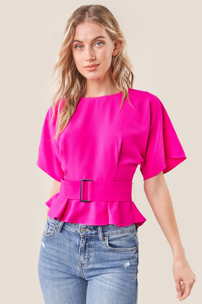 UNIKONCEPT: Lifestyle boutique; image shows a short sleeve peplum blouse by sugar lips. The rise up top is a bright hot pink colour and features a thick belt wrapping around the waist with two buttoned key hole back.