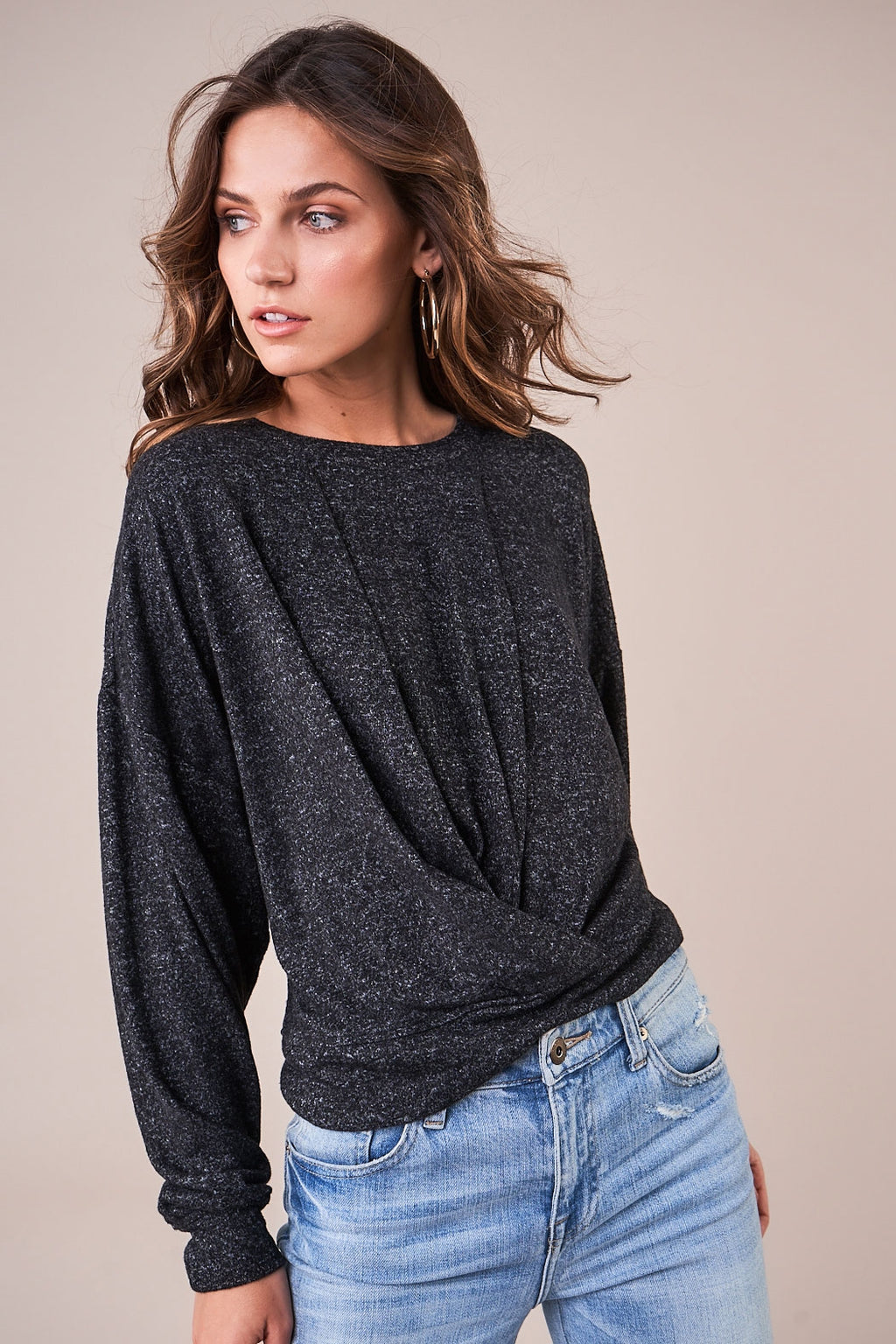 UNIKONCEPT: Lifestyle boutique; Image shows a grey long sleeve knit sweater by sugar lips. The cozy twist knit features a crew neckline and a twisted bottom waistband. It his dark grey in colour.