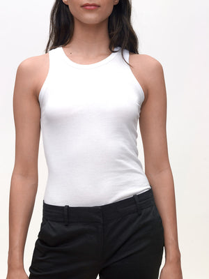 Model wearing White, High Neck slim, KOTN Tank Top.