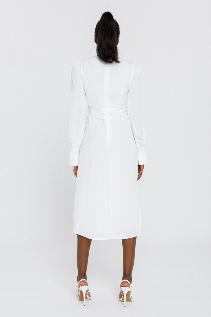 UNIKONCEPT Lifestyle boutique; Image shows the Skylar Dress in Ivory by English Factory. This elegant dress features a plunging neckline that ends in a twist detail in the centre front of the dress. The dress is knee length and features draping long sleeves. The A-line silhouette is extremely flattering.