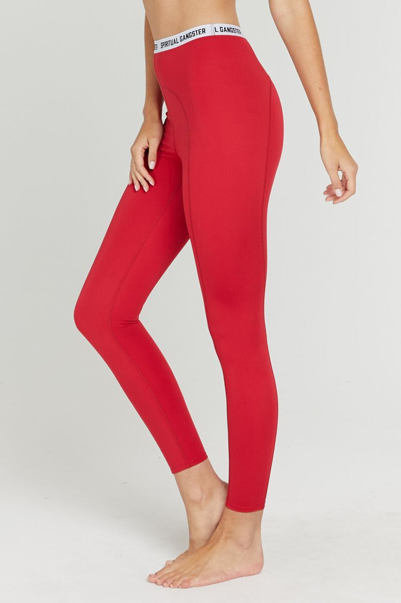 "Model is wearing crimson red, full length spiritual gangster legging. The says active tight in crimson comes with white slim band around the high-waist that reads ""spiritual gangster""."