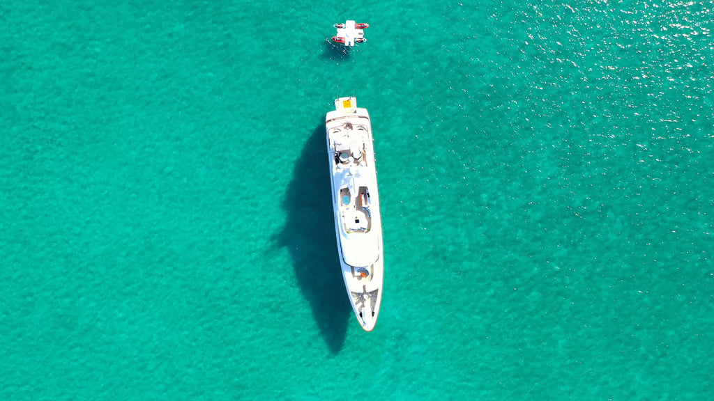View of FunAir Toy Island tethered to a superyacht from a drone