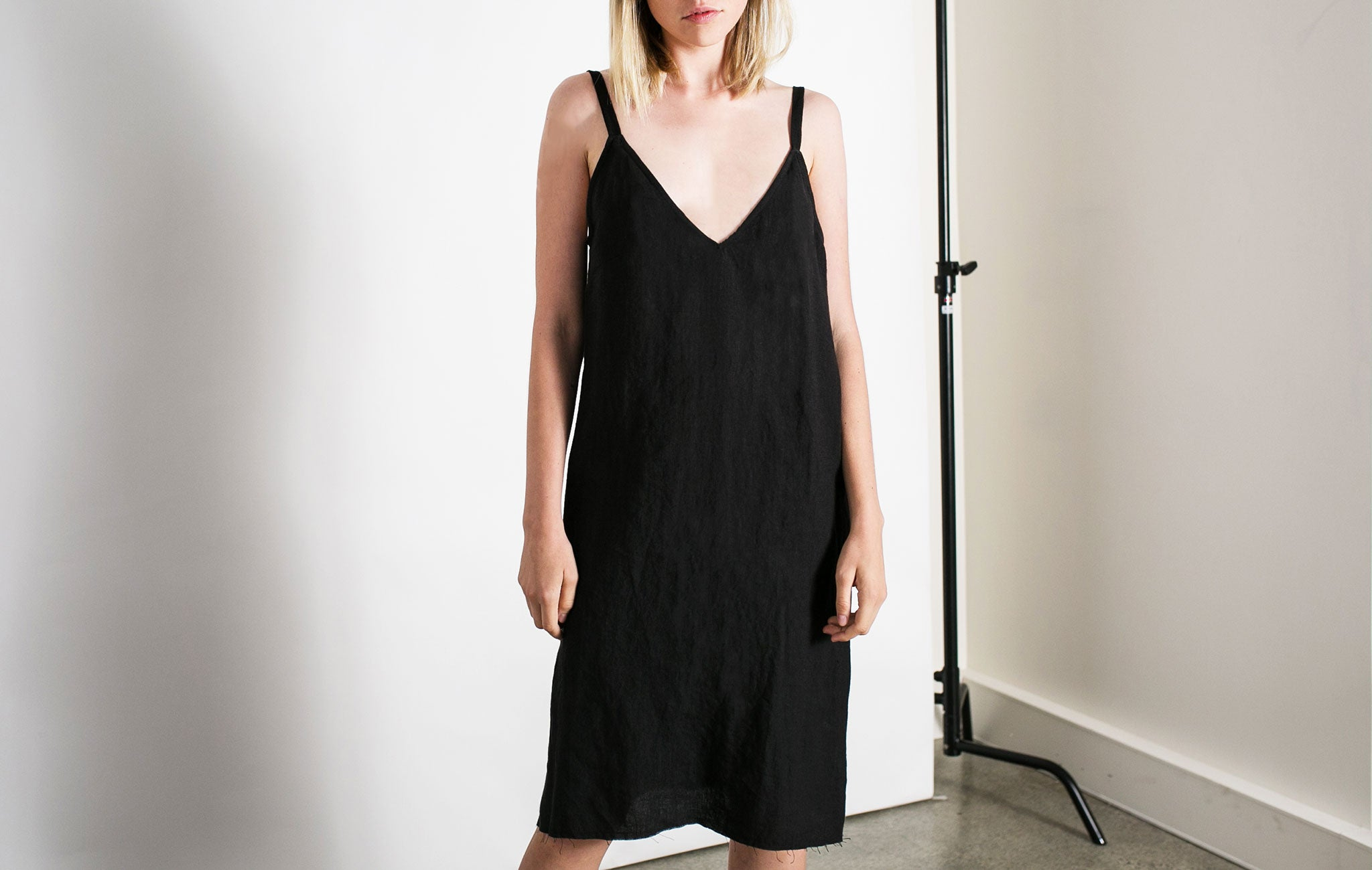 Matin V neck linen dress in black from The UNDONE