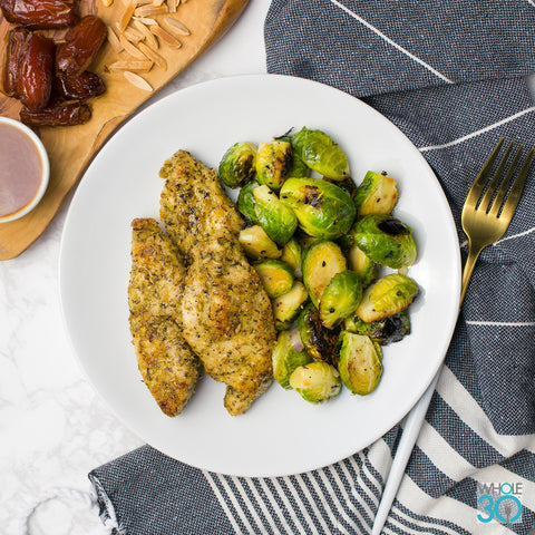 almond crusted pasture-raised chicken strips + charred brussels sprouts with sweet and sour sauce