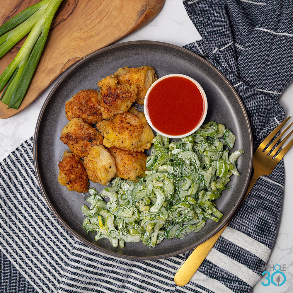 pasture-raised buffalo popcorn chicken + dill celery cucumber salad and ranch dressing