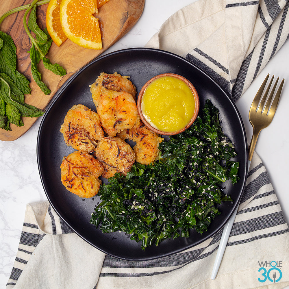 coconut crusted wild shrimp with mango lime dipping sauce + sautéed sesame kale